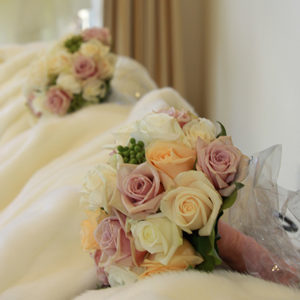 Wedding flowers featuring mixed colour roses